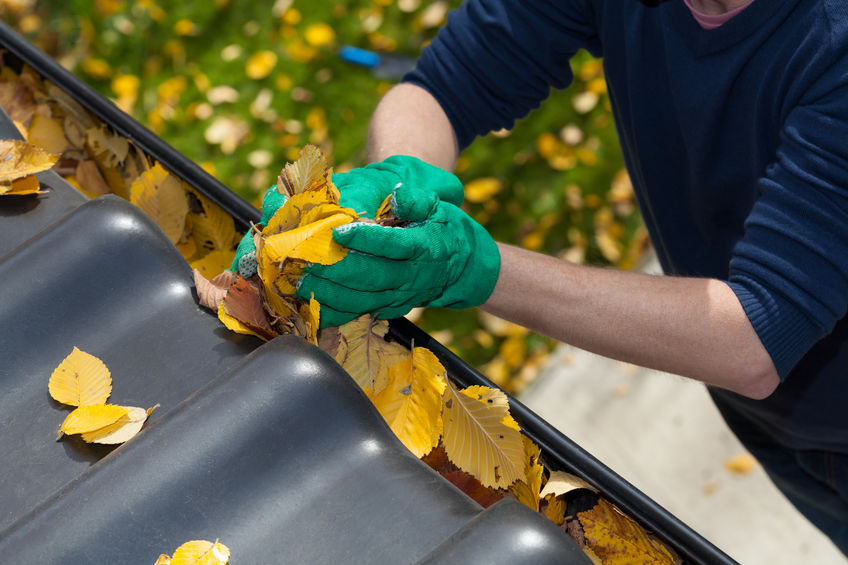 cleaning gutters as part of sewer maintenance