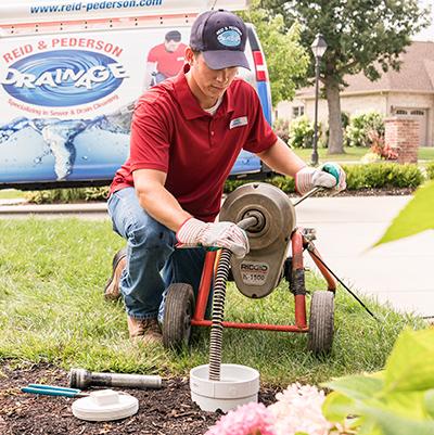 Tech sewer rodding in yard